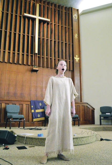 "Emma Kyler, 12, of Lima, daughter of Amanda and Chad Kyler, rehearses ""Amahl and the Night Visitors."" The Gian Carlo Menotti opera will be presented at the First Presbyterian Church in Sidney, Saturday, Dec. 2, at 7 p.m. Admission is free. Emma plays the part of Amahl. The musical recounts the story of the first Christmas."