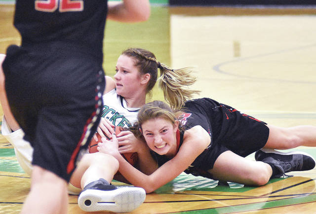 Anna's Kiplyn Rowland, left, and Fort Loramie's Kenzie Hoelscher vie for ball control at Anna Tuesday.