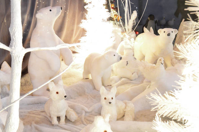 An all white display in a Ron & Nita's shop window has polar bears and arctic foxes next to white doves. The Sidney Daily News will run photos daily through Dec. 23 in the annual Countdown to Christmas. Readers are invited to submit ideas for holiday-themed photos for consideration. We may not be able to print every one we receive, but we will consider all submissions. Email location information to lgronneberg@aimmediamidwest.com or call 538-4820.