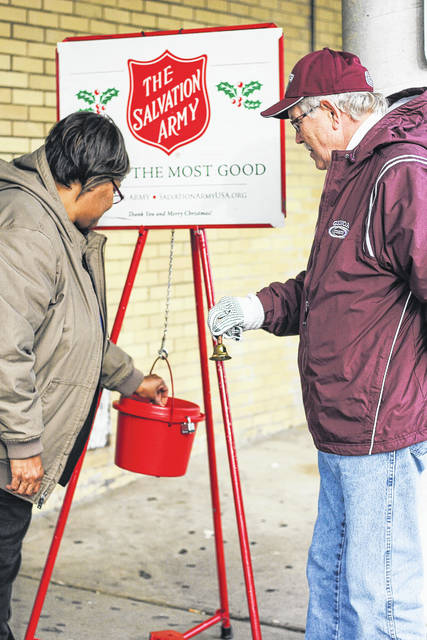 The Salvation Army's red kettles have returned to Sidney in preparation for the holiday season. Erica Smith, of Greenville, left, drops money into the kettle while Greg Wilt, of Sidney, rings the bell Friday. The kettle drive started Friday and will continue until Dec. 23. Currently, the kettles are located at Sidney Foodtown and Kroger. Beginning Black Friday, the kettles will also be found at Walmart.