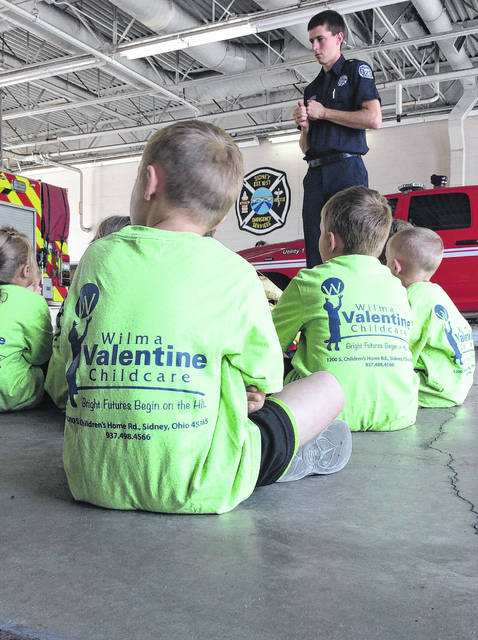 Sidney Firefighter/EMT Mike Terrian talks with children from Wilma Valentine Childcare during a recent tour of the fire station.