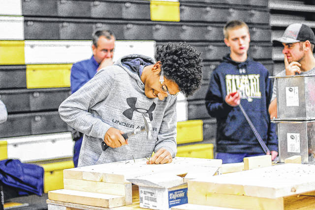 Dominic Durr, son of Amanda Driskell, of Sidney, participates in a skilled trade workshop at Sidney High School, Thursday, Nov. 9. The program was provided by the Shelby County Workforce Partnership.