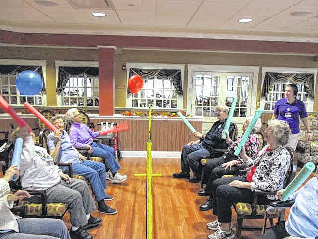 Residents of Elmwood Assisted Living in New Bremen enjoy a game of balloon volleyball, recently.