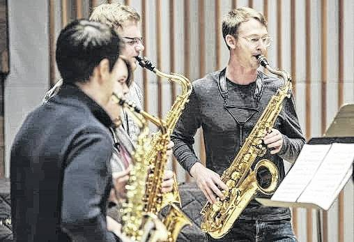 Michael Sawzin, a 2009 Wright State graduate, playing with Wright State saxophone students during his quartet's master class in Schuster Hall.