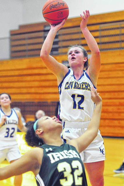 Mike Ullery | AIM Media Midwest Lehman Catholic's Grace Monnin shoots over Catholic Central's Abbigail Peterson Thursday night.
