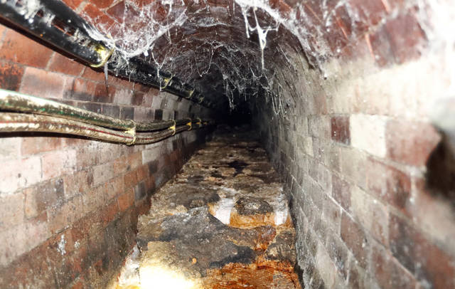 FILE - This is Monday, Sept. 25, 2017 file photo of a fatberg covering an 1852-built sewer at Westminster in London. Part of a  different monster fatberg that clogged one of London's sewers is destined for fame in a museum. The Museum of London said Tuesday Dec. 12, 2017 it will put the only remaining chunk of the 130 metric ton (143 U.S. ton) mass of oil, fat, diapers and baby wipes on display early next year.  (AP Photo/Frank Augstein, File)