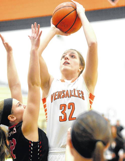 Versailles Danielle Winner shoots with pressure from Fort Loramie's Marissa Meiring on Saturday.
