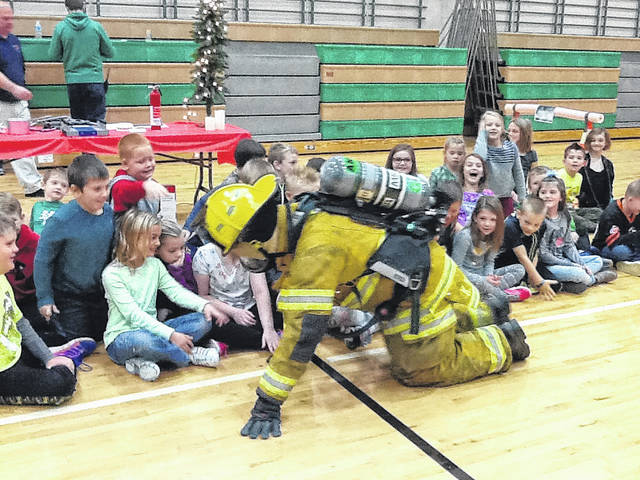 Anna Elementary School recently held a gun and fire safety day for their students. Participating in the event were Anna Police Chief Tim Bender, Captain Nick Bender, firefighters Brad Boyd, Bryan Doak and Kevin Hammergren. Shelby County Sheriff's Office Deputy Lynn Marsee taught gun safety.