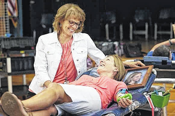 Botkins donor Susan Leugers, right, with Community Blood Center's Kathy Pleiman.
