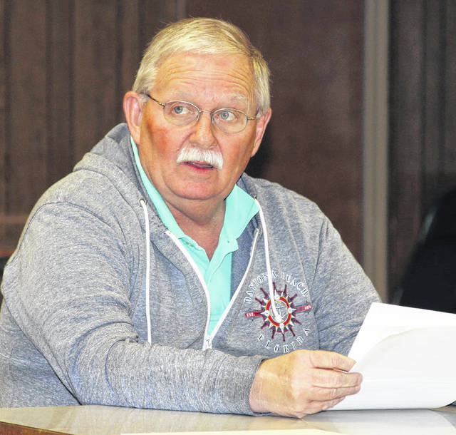 Port Jefferson Mayor Steve Butterfield listens to questions for local Attorney Keith Schnelle concerning the sale of village property for the purpose of constructing a new firehouse.