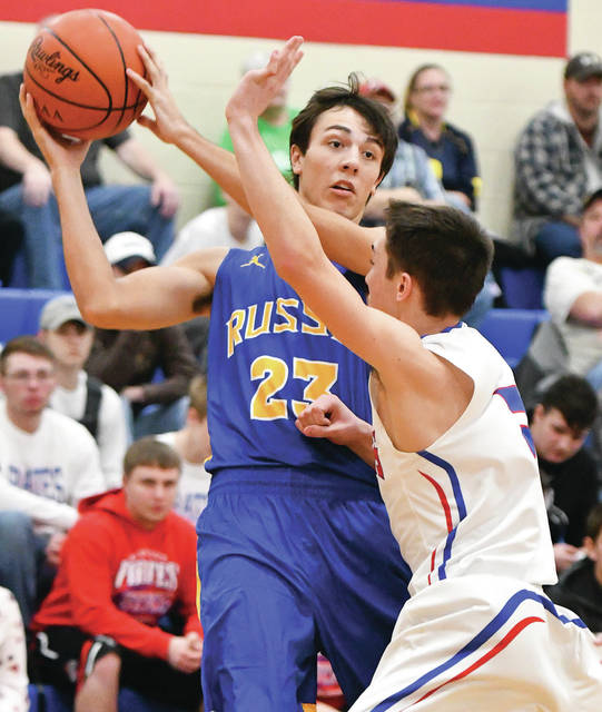 Russia Jack Dapore looks to pass with pressure from Riverside's Jaxon Heath during a nonconference game on Saturday.