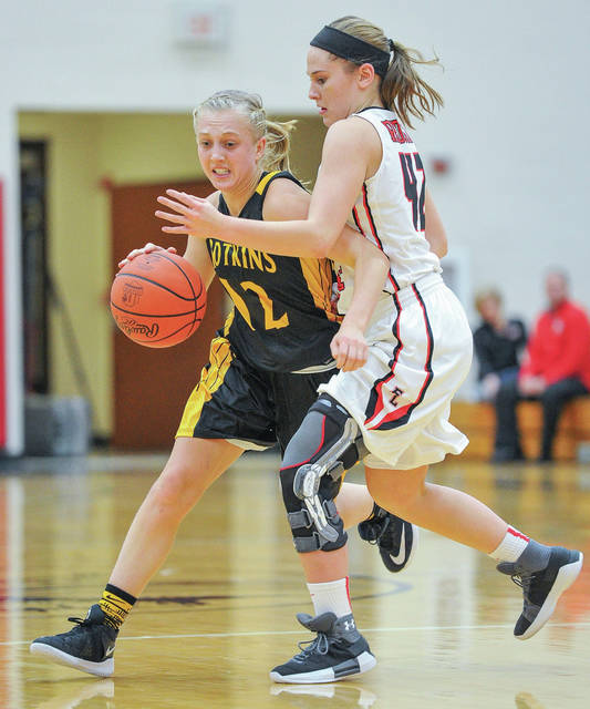 Botkins junior guard Taira Greve dribbles with pressure from Fort Loramie's Marissa Meiring during a Shelby County Athletic League game on Saturday. Meiring scored 11 points for the Redskins.