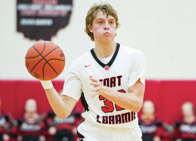 Fort Loramie senior guard Dillon Braun throws a pass during a game against New Knoxville on Dec. 2. Braun averages 19.4 points per game for the Redskins.