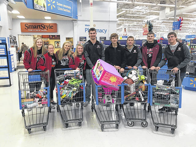 Members of the girls and boys basketball teams at Fort Loramie High School shop for items to donate to the Salvation Army, recently.