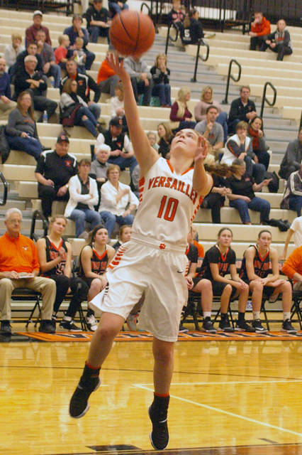 Versailles' Kami McEldowney shoots during a Midwest Athletic Conference game against Coldwater on Thursday.