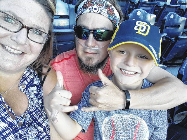 Jason Overbey, his wife Monica, and son Micah enjoy a baseball game. Overbey suffers from an ailment known as CTEPH and wants to share his story to help others recognize it. Many people are not diagnosed with CTEPH until after their death.