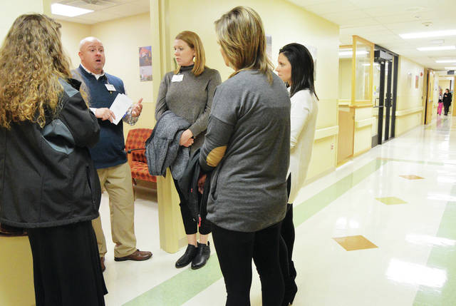 Grand Lake Health System CEM Tommy Williamson, second from left, of VanWert, gives a tour of the new Clear Passage Geriatric Psychiatric Center in St. Marys to, left to right, LSW Charleen Brunswick, of Coldwater, Stacy Klosterman, of Celina, Otterbein Director of Nursing Beth Newbauer, of St. Marys, and Otterbein Assistant Director of Nursing Kristen Shaffer, of Celina. The new facility located at the Joint Township District Memorial Hospital had a ribbon cutting and open house Tuesday, Dec. 5. The facility has 12 beds and a program dedicated to helping seniors experiencing cognitive impairments and behavioral difficulties.