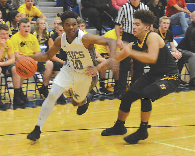 Xenia's R.J. Hunter drives around a Sidney's Keith Lee in the first half of a game on Tuesday.