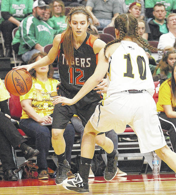Jackson Center's Peyton Esser drives against a St. Wendelin during a Division IV state semifinal on March 16. The Tigers advanced to the Div. IV state semifinals for the second consecutive season.