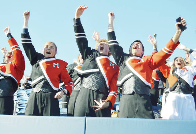 Members of the Minster High School band chant as their football team closes in on a win in the fourth quarter in the Division VII state championship in Canton.