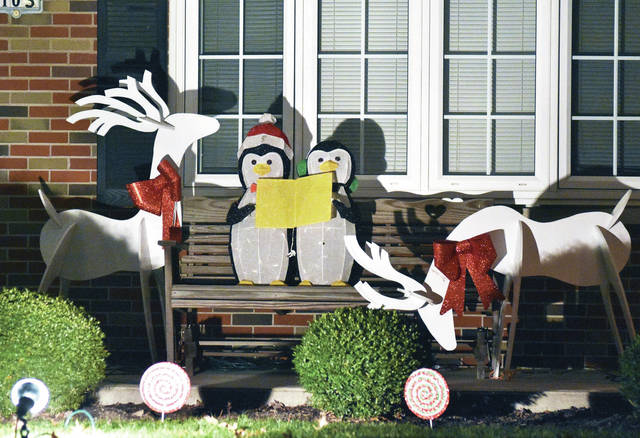 A pair of penguins sing to reindeer at a house on Highland Drive in Russia. They are helping the Sidney Daily News with its countdown to Christmas. There are 18 days until Christmas.