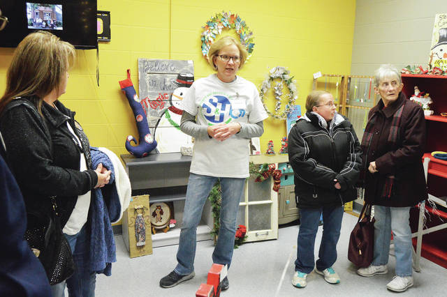 S&H Products art studio support specialist Ann Barhorst, second from left, gives a tour of the S&H Products art shop in its new location in the S&H Products building, Thursday, Dec. 7. With Barhorst are, left to right, Deb Motsinger, of Sidney, S&H Products Associate Ashley Patterson, of Piqua, and Anita Cromes, of Sidney. The tour was part of a Shelby County Chamber of Commerce Business After Hours event.