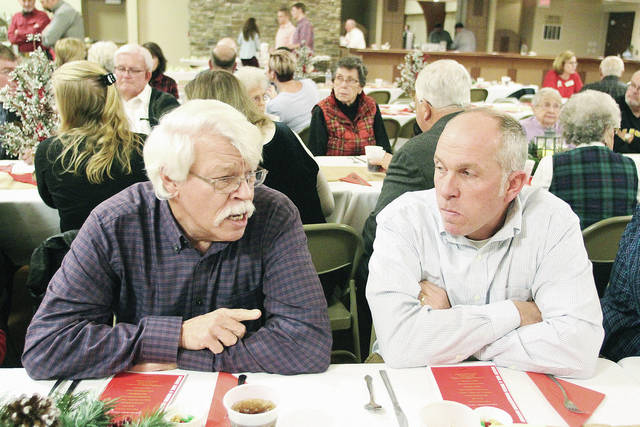 Steve Knouff, left, of Sidney, talks with his newphew Pat Knouff, of Minster, during the Shelby Soil and Water Conservation District's 71st Annual Meeting and Banquet Thursday, Dec. 7. The two men came accepted the Outstanding Cooperator of the Year award on behalf of the Knouff Farm. The evening's speaker was WHIO reporter Steve Baker. The event was held at St. Michael's Hall in Fort Loramie.
