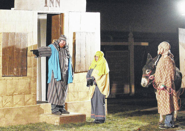 """Sidney First Church of the Nazarene congregation members perform in the 2016 live nativity drive-through program. This year's event, """"Return to Bethlehem,"""" will be Dec. 9 and 10."""