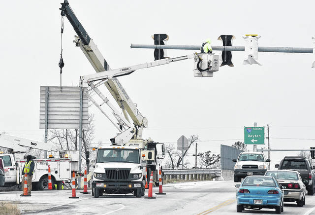 Workers install stop lights at the St. Marys Road (state Route 29) exit at Interstate 75 Wednesday, Dec. 13. The lights will be blinking yellow and red by the end of the month and they will be fully functional by the end of January.