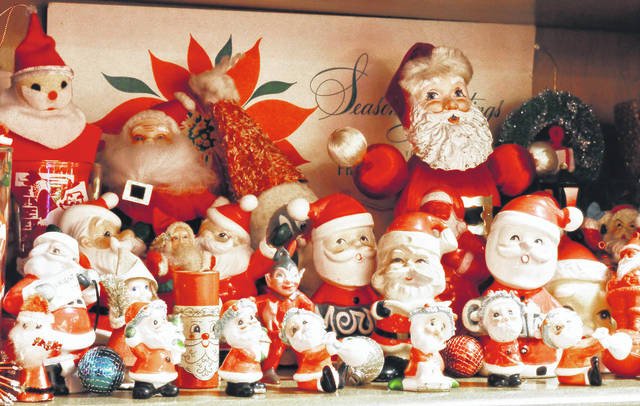 COUNTDOWN TO CHRISTMAS: There are 11 days until Christmas. A collection of Santa figurines from the 50's, 60's and 70's is the tip of the iceberg for Christmas decorations used to decorate the house of Rob Current and Betty Kendall, of Sidney. Current and Kendall also have figurine collections of elves and carolers. Old Christmas decorations glow around their living room floor next to their decked out tree and hang from the walls as well.