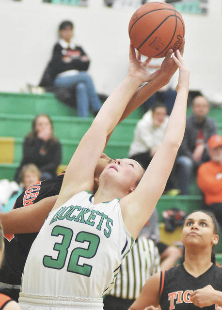 Anna's Jada Rowland reaches up for a rebound at the same time as West Liberty-Salem's Selena Weaver. Watching is Alex Burton at Anna on Thursday.