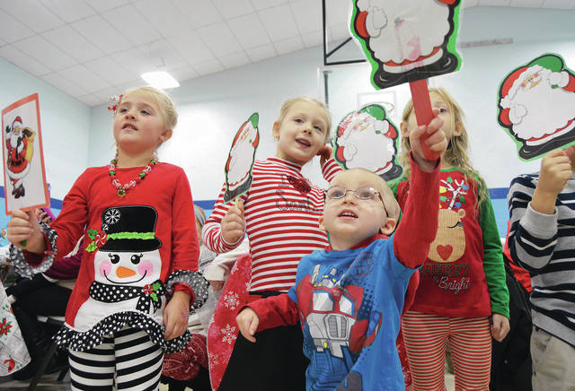 COUNTDOWN TO CHRISTMAS. There are 10 days until Christmas. Singing Christmas songs during the Shelby Hills Early Childhood Center Christmas program are, left to right, Brenna Davis, 5, daughter of Dallas and Bridget Davis, Maggie Clark, 5, daughter of Carrie and Chris Clark, Ryan Lawrence, 3, son of Brittany Dankworth and John Lawrence, and Aurora Smith, 5, daughter of Cheyann Berryhill, all of Sidney. Kids also decorated cookies and picture frames.