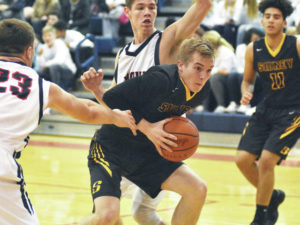 Boys basketball: Big fourth quarter run lifts Sidney over Piqua