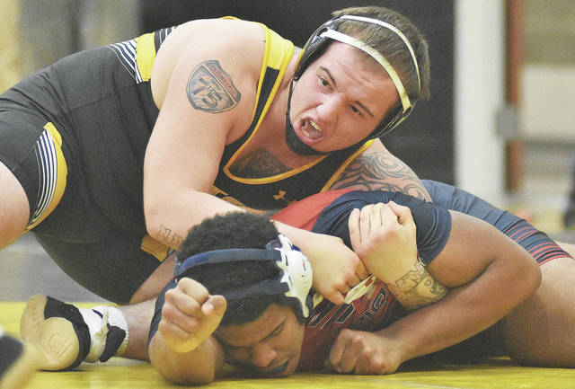 Sidney's Jordan Marvin, top, pins Piqua's Lance Reaves, at 220 pounds at Sidney Middle School on Wednesday.