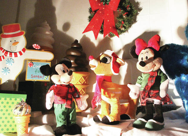 "COUNTDOWN TO CHRISTMAS: There are three days until Christmas. Mickey and Minnie Mouse hang with the ""most famous reindeer of all"" inside the front display case of the Dairy King & Motel in Fort Loramie."