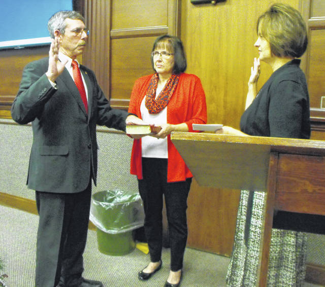 Council member Steve Wagner, representing the 4th ward, was sworn-in with his wife at his side by City Clerk Kari Egbert after being re-elected to council in November during a special Sidney City Council meeting, Monday.