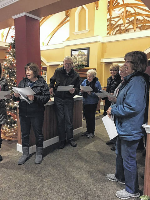 A group of carolers from the Faith Alliance Church stopped by Elmwood of New Bremen to sing to all for the Christmas season. They also went room to room and at sang at the fireplaces and gathering areas.