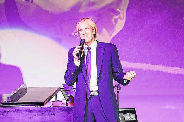 John Tesh performs in front of an audience of nearly 450 at the Edison Foundation's 20th annual Holiday Evening at Edison State.