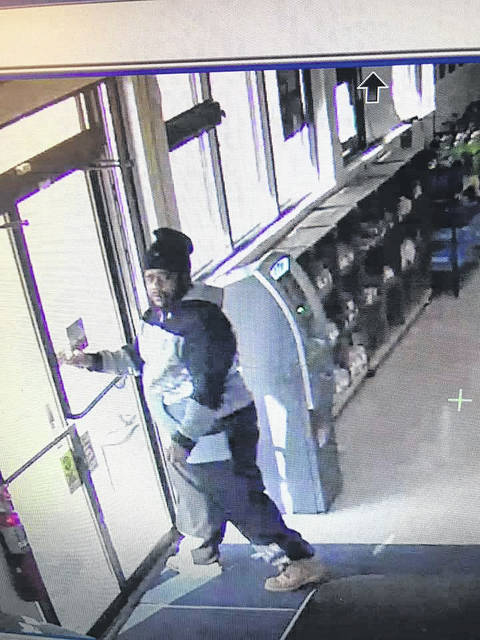 A surveillance photo of a man suspected of passing counterfeit $100 bills in Minster, New Bremen and Fort Loramie. Anyone with information or anyone who sees this man should call the Shelby County Sheriff's Office at 498-1111.