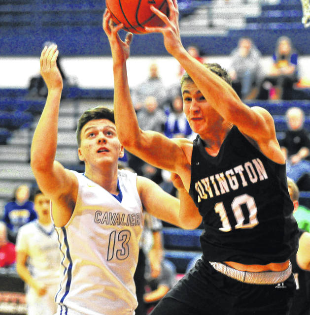 Andrew Cates, right, of Covington pulls down a rebound against Lehman's Ryan Schmidt.