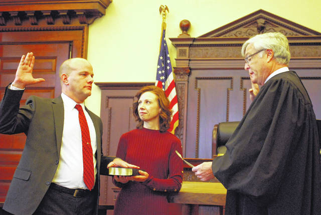 Andrew Augsburger was issued the oath of office as Auglaize County's municipal court judge during ceremonies Friday. Common Pleas Court Judge Frederick Pepple issued the oath as Augsburger's wife, Candice, held the Bible. Augsburger succeeds Judge Gary Herman, who retired after 36 years on the bench.