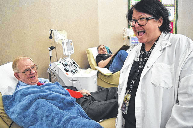 Donor Al Whitney with CBC's Amanda Wilson during a blood donation in Dayton.