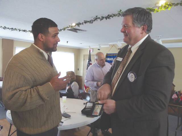 Shane Carter, Lincoln Community Center director, talks with Ed Thomas, Sidney-Shelby County YMCA executive director, following the Sidney Rotary and Sidney Kiwanis clubs meeting on Jan. 17. Carter discussed the Lincoln Community Center and the importance of Dr. Martin Luther King Jr. on his life.