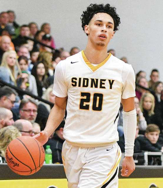 Sidney junior guard Andre Gordon dribbles during a game against Bellefontaine on Dec. 30. Gordon scored 40 points against Stebbins on Tuesday.