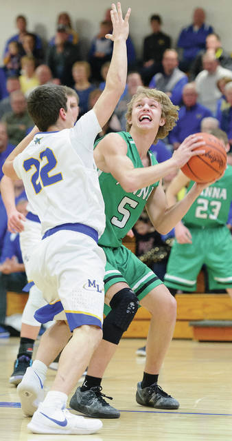 Anna senior guard Wyatt Bensman shoots with pressure from Marion Local's Matt Rethman during a nonconfernece game on Saturday at The Hangar.