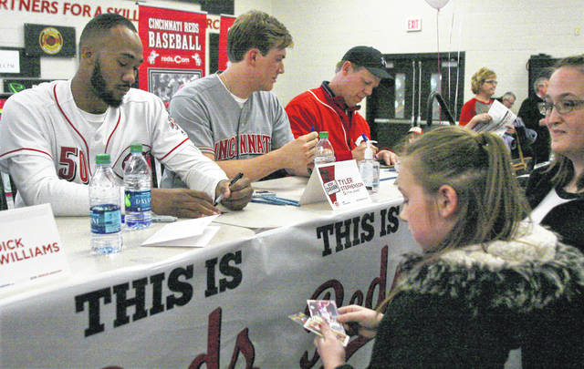 Reds pitcher Amir Garrett, shown here signing autographs during at the Reds Caravan on Friday at the Apollo Center in Lame, said he expects to make the starting rotation this year.