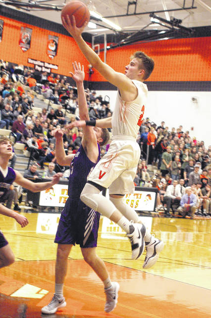 Versailles' Justin Ahrens scores on a drive to the basket Friday night against Fort Recovery. He became the Versailles High School and Midwest Athletic Conference's all-time leading scorer in the game.