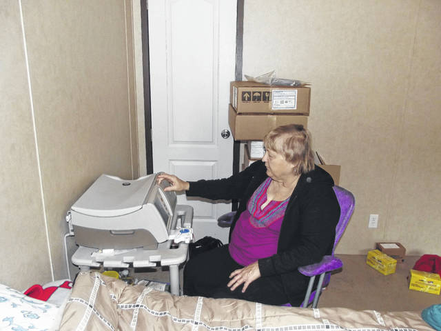 Linda Draving, of Sidney, explains how the recycler works each night while she's sleeping. Because of the machine, she's able to do her kidney dialysis at home.