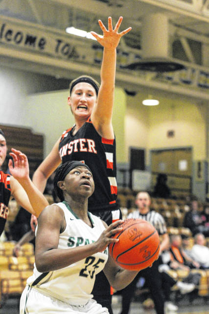 Minster senior Taylor Kogge goes up to block the shot of Toledo Start's Malena Ricks during a semifinal of the McDonald's Holiday Classic at Lima Bath on Dec. 29.