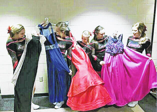 Fort Loramie High School junior cheerleaders check out dresses that may be in their prom dress exchange, Jan. 14. They are, from left, Alexis Fleckenstein, daughter of Jill and Eric Fleckenstein; Jana Poeppelman, daughter of Sharon and Kurt Poeppelman; Emily Austin, daughter of Barb and Jamie Austin; Aleah Frilling, daughter of Greta and Randy Filling; and Rylee Poeppelman, daughter of Jill and Gary Poeppelman.